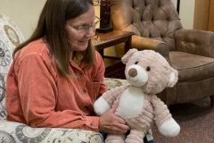 woman-resident-with-teddy-bear